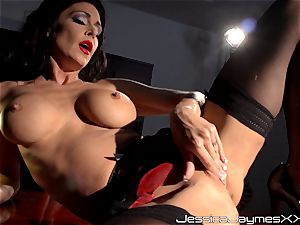 horny brunette Jessica Jaymes frigs her succulent coochie pie in her office