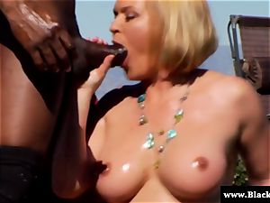 chesty Krissy Lynn deep throating big black cock outdoors in the sun
