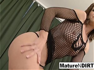 dark haired milf wanks before taking a big black cock